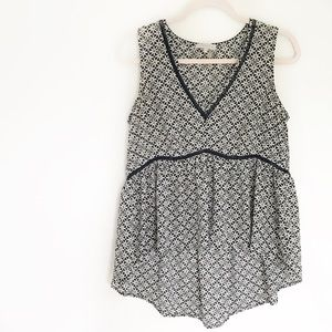 1. State V Neck Patterned High Low Tank Top